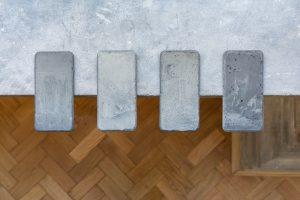 Barbara Żłobińska oraz Mariusz Maślanka, Untitled, 2019, Grawer laserowy, grafiki Gustave Doréa na gipsowych odlewach iPhone 7 Plus, 8 x 16 x 0,5 cm